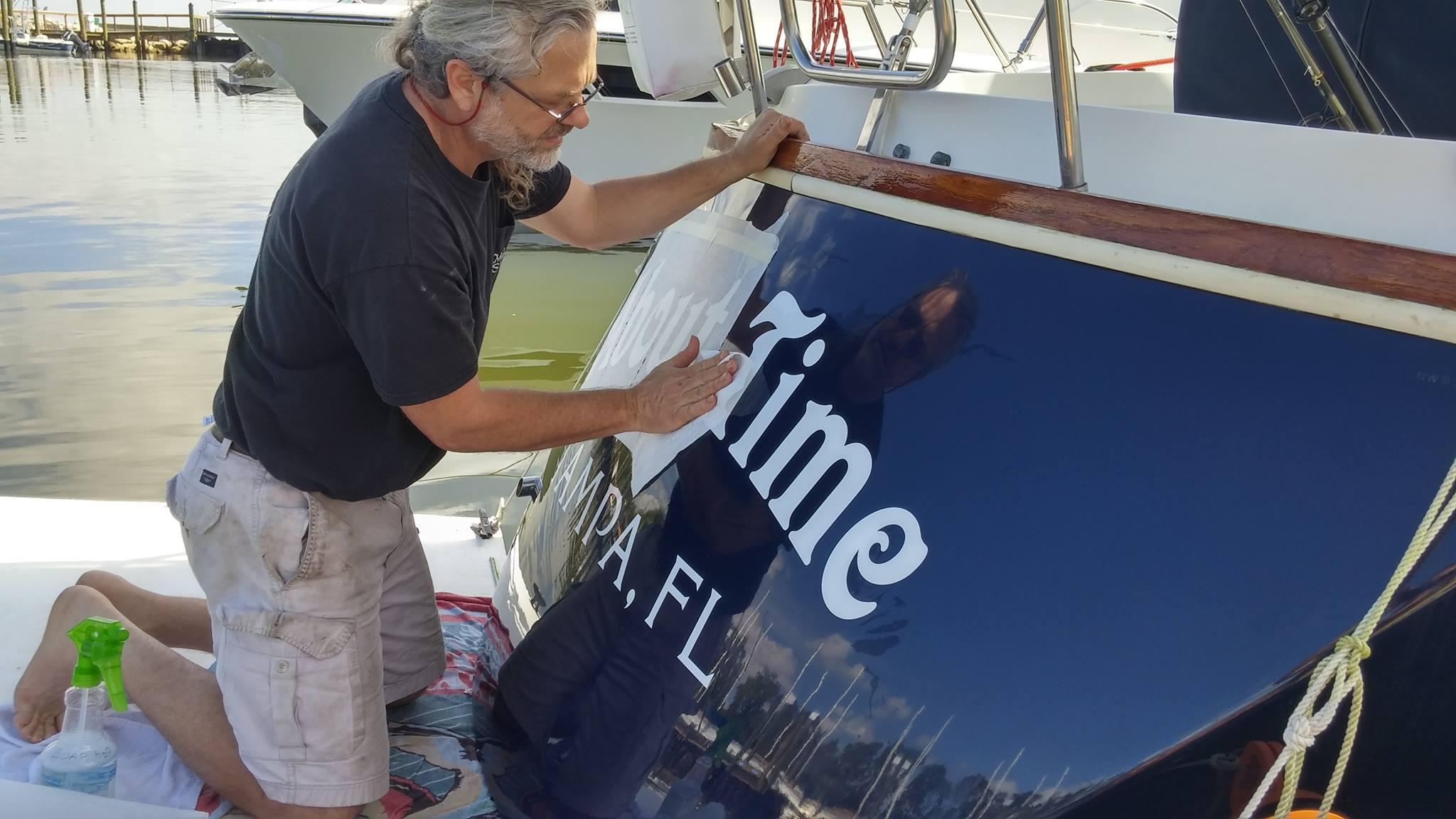 Installing_Vinyl_Boat_Name_Tampa
